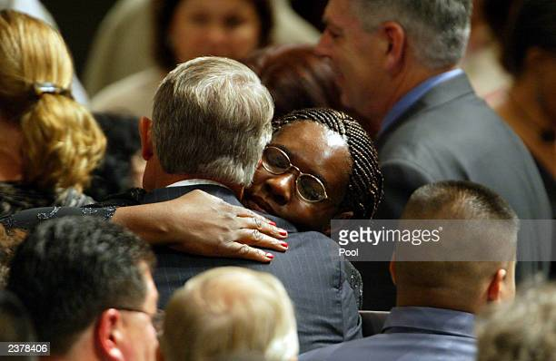 Valorie Brabazon gets a long hug from Baylor Athletic Director Tom Stanton following memorial services for her son Patrick James Dennehy August 7...