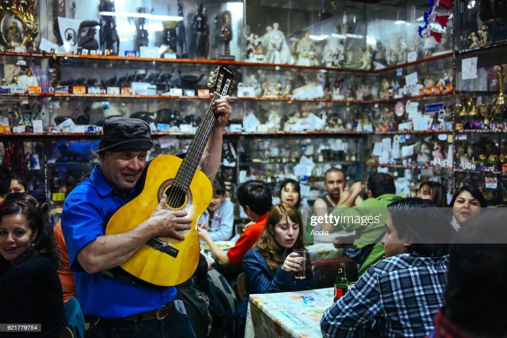 Valparaiso (Chile), city registered as a UNESCO World Heritage Site. Atmosphere at night in a typical restaurant, J. Cruz. Musician, guitarist.