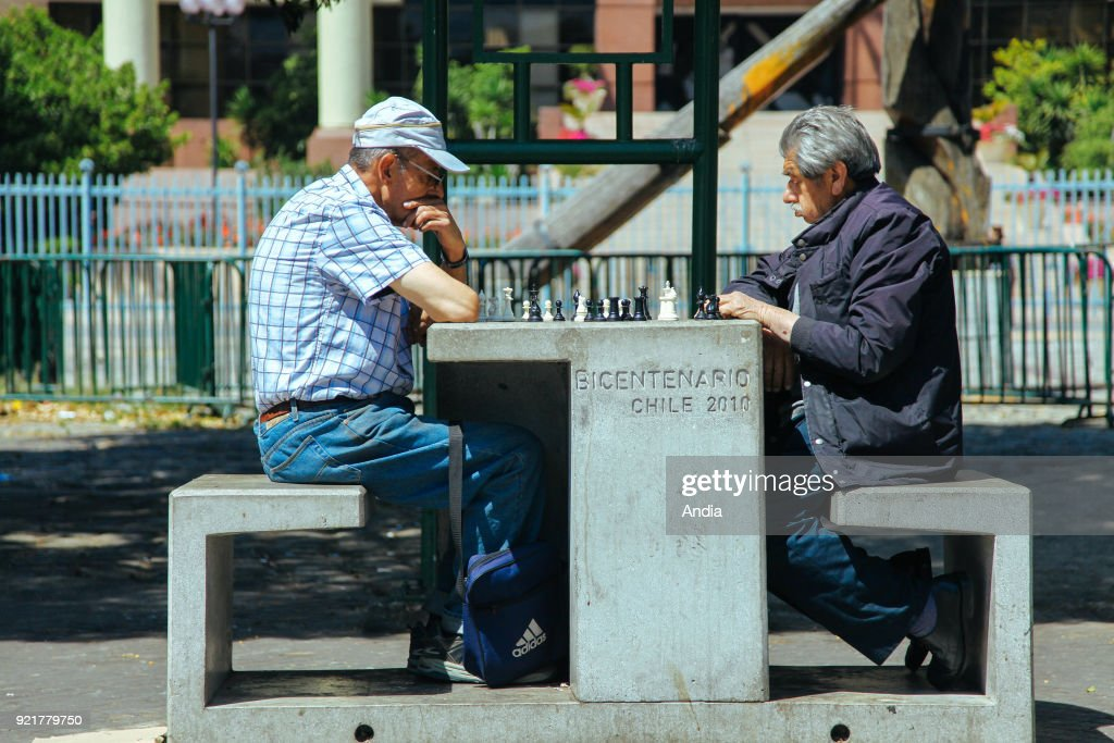Valparaiso (Chile), city registered as a UNESCO World Heritage Site. Retired people playing chess in the town.