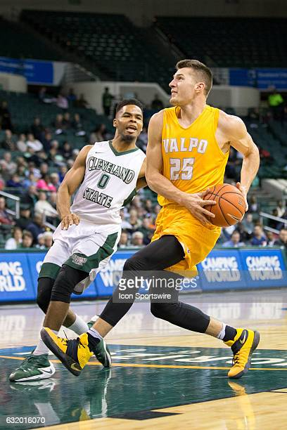 Valparaiso Crusaders F Alec Peters drives to the basket against Cleveland State Vikings F Derek Sloan during the second half of the NCAA Men's...