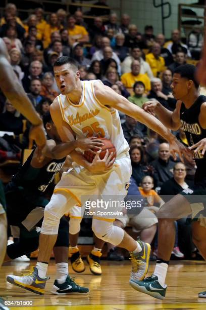 Valparaiso Crusaders forward Alec Peters battles with Cleveland State Vikings for the basketball in action during the first half of a game between...