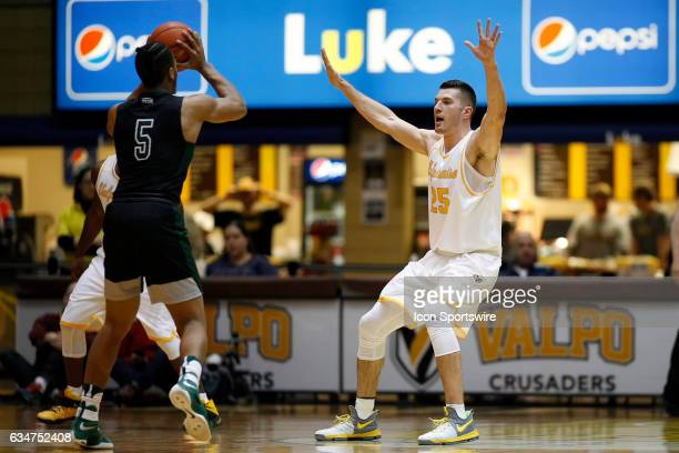 Valparaiso Crusaders forward Alec Peters defends against Cleveland State Vikings forward Jibri Blount in action during the first half of a game...