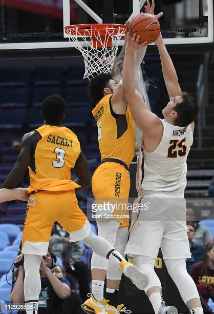 Valparaiso forward Markus Golder and Loyola Ramblers guard Cameron Krutwig grab a rebound during a Missouri Valley Conference Basketball Tournament...