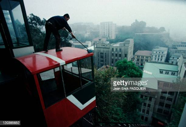 Valparaiso in Chile Yes even the roof of a funicular must be cleaned Rather dangerous exercice for someone with a lack of balance Which is obviously...
