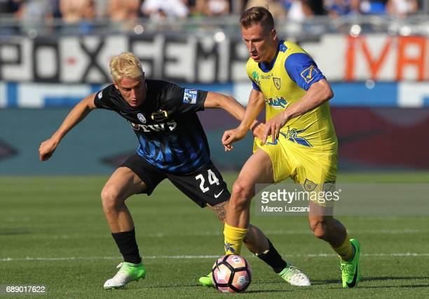 Valter Birsa of AC Chievo Verona competes for the ball with Andrea Conti of Atalanta BC during the Serie A match between Atalanta BC and AC...