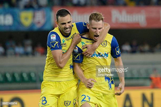 Valter Birsa of AC ChievoVerona celebratewith his team's mate Ivan Radovanovic after scoring his team's secomd goal during the Serie A match between...