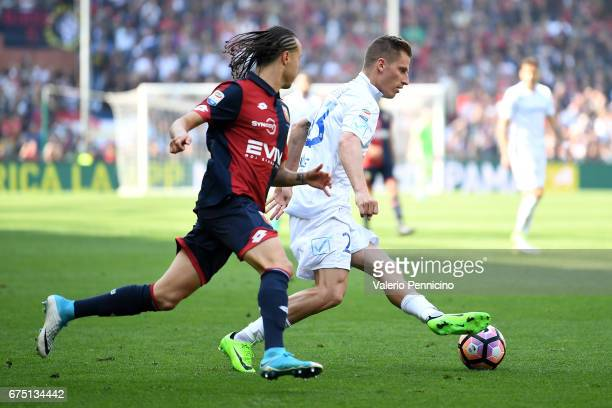 Valter Birsa of AC ChievoVerona in action against Diego Laxalt of Genoa CFC during the Serie A match between Genoa CFC and AC ChievoVerona at Stadio...