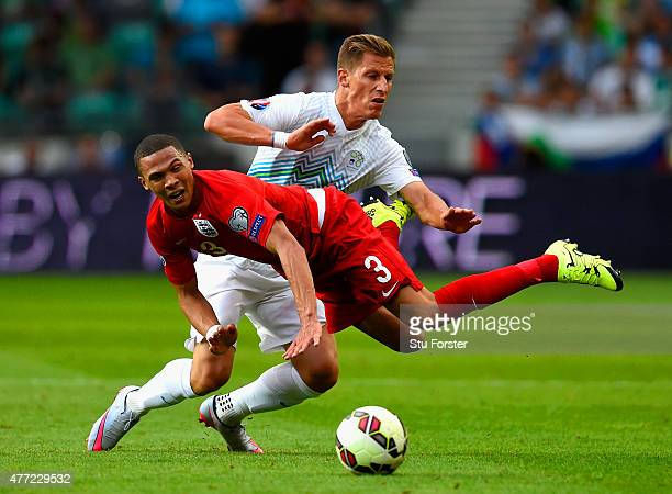 Valter Birsa of Slovenia fouls Kieran Gibbs of England during the UEFA EURO 2016 Qualifier between Slovenia and England on at the Stozice Arena on...