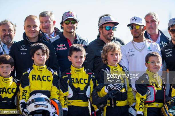 Valterri Bottas of Mercedes and Finland Carlos Sainz of Scuderia Toro Rosso and Spain Fernando Alonso of McLaren and Spain Lewis Hamilton of Mercedes...