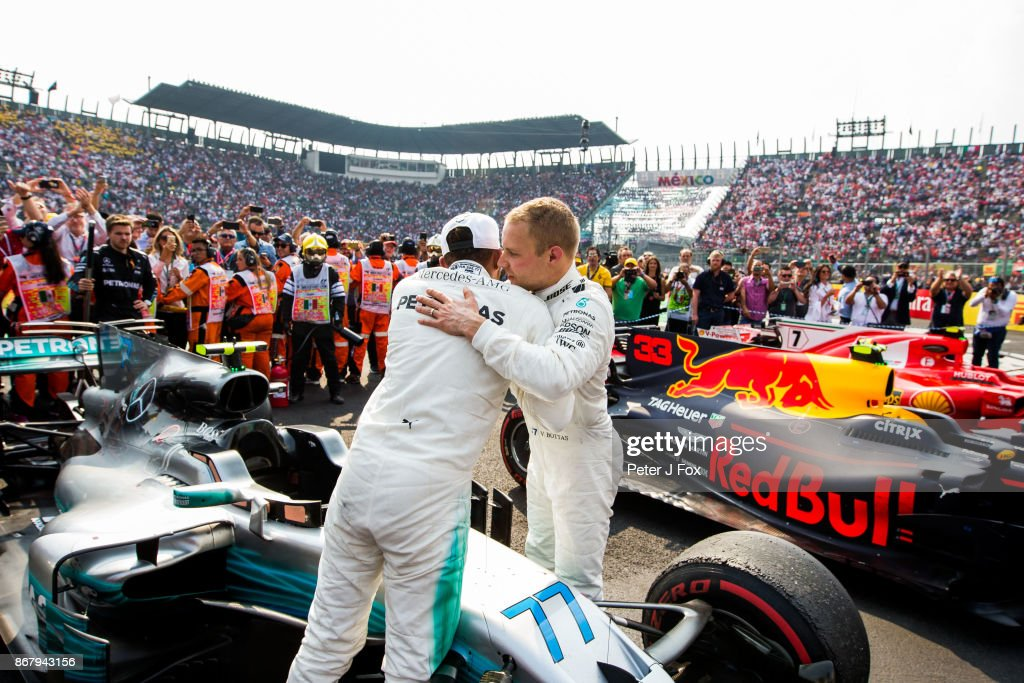 Valterri Bottas of Mercedes and Finland congratulates Lewis Hamilton of Mercedes and Great Britain on becoming the 2017 Formula One Drivers World Champion during the Formula One Grand Prix of Mexico at Autodromo Hermanos Rodriguez on October 29, 2017 in Mexico City, Mexico.
