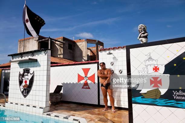 Valtinho 'Vascaino' Cabral a Vasco da Gama football club fanatic takes a poolside shower surrounded by the club's memorabilia Saquarema Brazil 15th...