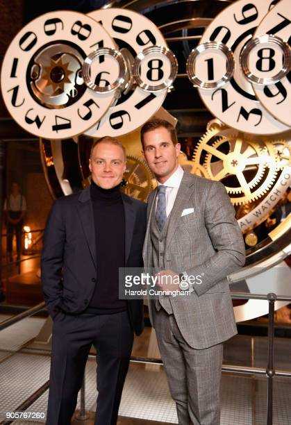 Valtteri Bottas and Christoph GraingerHerr visit the IWC booth during the Maison's launch of its Jubilee Collection at the Salon International de la...
