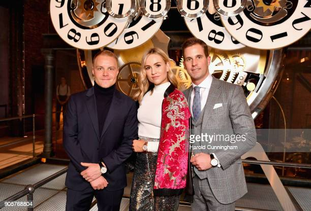 Valtteri Bottas Carmen Jorda and Christoph GraingerHerr visit the IWC booth during the Maison's launch of its Jubilee Collection at the Salon...
