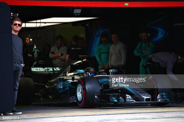 Valtteri Bottas driving the Mercedes AMG Petronas F1 Team Mercedes F1 WO8 prepares to leave the garage as 2016 F1 World Drivers Champion Nico Rosberg...