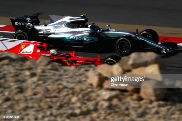 Valtteri Bottas driving the Mercedes AMG Petronas F1 Team Mercedes F1 WO8 passes Sebastian Vettel of Germany driving the Scuderia Ferrari SF70H on...