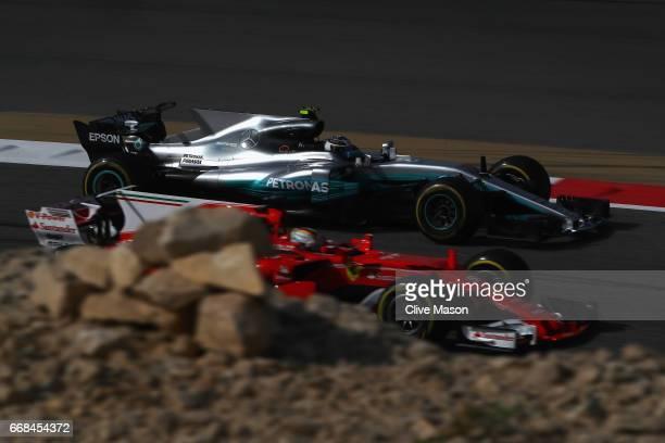 Valtteri Bottas driving the Mercedes AMG Petronas F1 Team Mercedes F1 WO8 passes Sebastian Vettel of Germany driving the Scuderia Ferrari SF70H on...