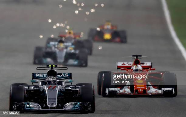 Valtteri Bottas driving the Mercedes AMG Petronas F1 Team Mercedes F1 WO8 leads Sebastian Vettel of Germany driving the Scuderia Ferrari SF70H on...