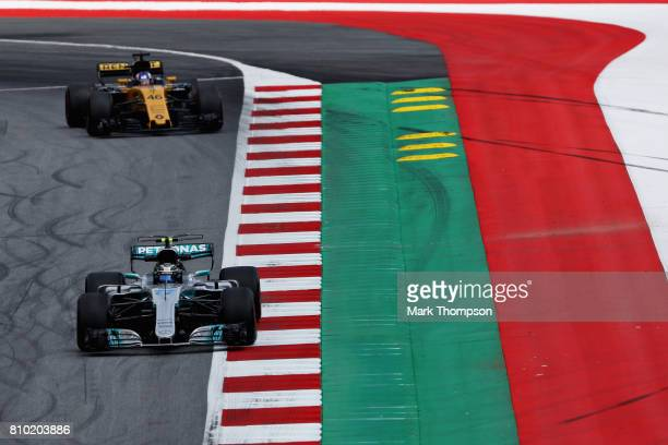 Valtteri Bottas driving the Mercedes AMG Petronas F1 Team Mercedes F1 WO8 leads Sergey Sirotkin of Russia driving the Renault Sport Formula One Team...