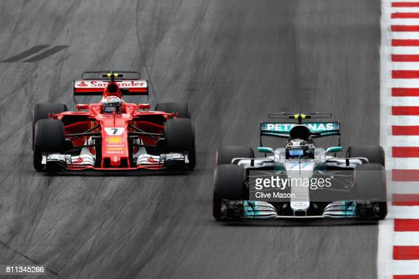 Valtteri Bottas driving the Mercedes AMG Petronas F1 Team Mercedes F1 WO8 and Kimi Raikkonen of Finland driving the Scuderia Ferrari SF70H on track...