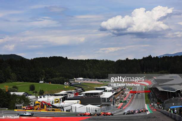 Valtteri Bottas driving the Mercedes AMG Petronas F1 Team Mercedes F1 WO8 leads the field round turn one at the start during the Formula One Grand...
