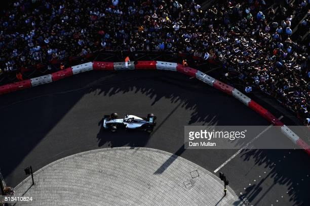 Valtteri Bottas driving the Mercedes AMG Petronas F1 Team Mercedes F1 WO8 drives the Mercedes F1 W06 during F1 Live London at Trafalgar Square on...