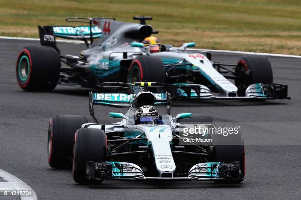Valtteri Bottas driving the Mercedes AMG Petronas F1 Team Mercedes F1 WO8 leads Lewis Hamilton of Great Britain driving the Mercedes AMG Petronas F1...