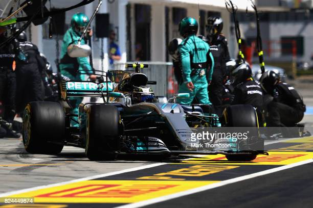 Valtteri Bottas driving the Mercedes AMG Petronas F1 Team Mercedes F1 WO8 makes a pit stop for new tyres during the Formula One Grand Prix of Hungary...