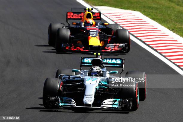Valtteri Bottas driving the Mercedes AMG Petronas F1 Team Mercedes F1 WO8 leads Max Verstappen of the Netherlands driving the Red Bull Racing Red...