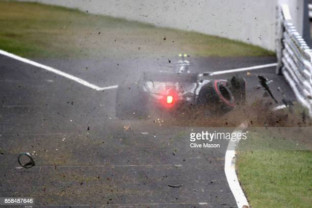 Valtteri Bottas driving the Mercedes AMG Petronas F1 Team Mercedes F1 WO8 crashes into a track barrier during final practice for the Formula One...