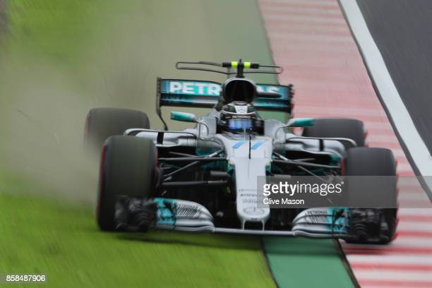 Valtteri Bottas driving the Mercedes AMG Petronas F1 Team Mercedes F1 WO8 runs wide during final practice for the Formula One Grand Prix of Japan at...