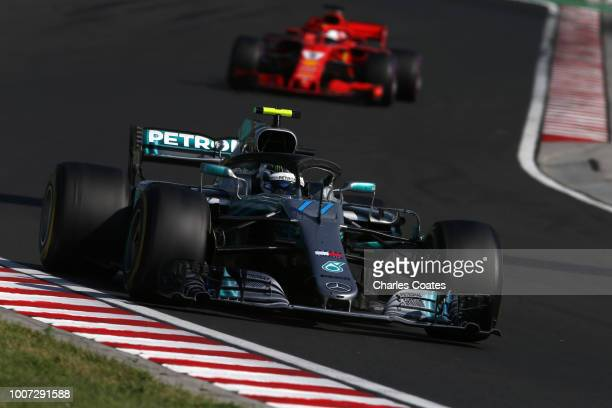 Valtteri Bottas driving the Mercedes AMG Petronas F1 Team Mercedes WO9 leads Sebastian Vettel of Germany driving the Scuderia Ferrari SF71H on track...