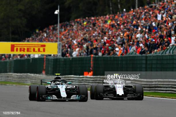 Valtteri Bottas driving the Mercedes AMG Petronas F1 Team Mercedes WO9 overtakes Sergey Sirotkin of Russia driving the Williams Martini Racing FW41...