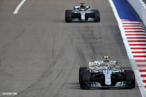 Valtteri Bottas driving the Mercedes AMG Petronas F1 Team Mercedes WO9 leads Lewis Hamilton of Great Britain driving the Mercedes AMG Petronas F1...