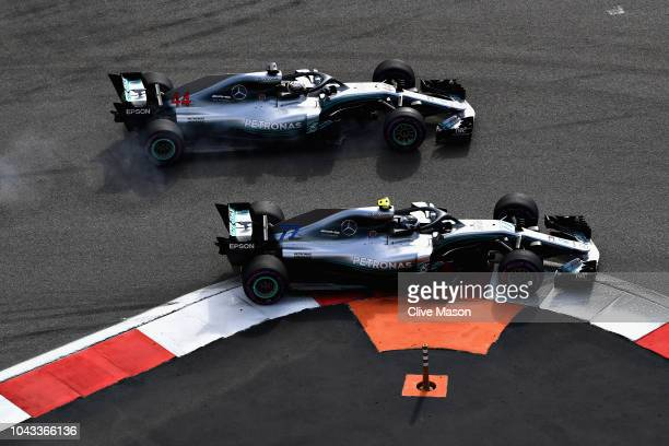 Valtteri Bottas driving the Mercedes AMG Petronas F1 Team Mercedes WO9 and Lewis Hamilton of Great Britain driving the Mercedes AMG Petronas F1 Team...