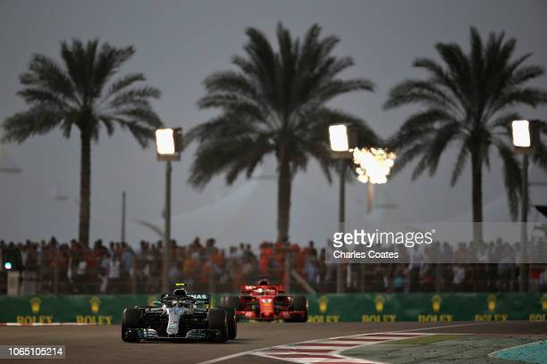 Valtteri Bottas driving the Mercedes AMG Petronas F1 Team Mercedes WO9 lead Sebastian Vettel of Germany driving the Scuderia Ferrari SF71H on track...