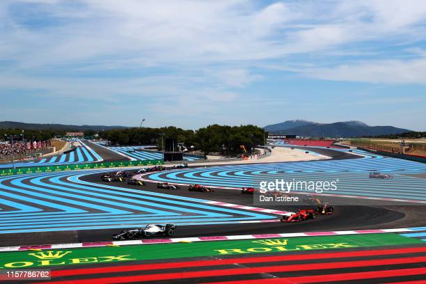 Valtteri Bottas driving the Mercedes AMG Petronas F1 Team Mercedes W10 leads Charles Leclerc of Monaco driving the Scuderia Ferrari SF90 on the first...