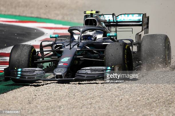 Valtteri Bottas driving the Mercedes AMG Petronas F1 Team Mercedes W10 runs wide during practice for the F1 Grand Prix of Austria at Red Bull Ring on...