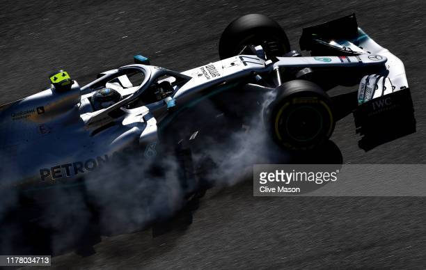 Valtteri Bottas driving the Mercedes AMG Petronas F1 Team Mercedes W10 locks a wheel under braking on the way to the grid before the F1 Grand Prix of...