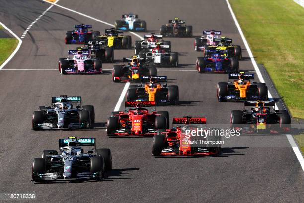 Valtteri Bottas driving the Mercedes AMG Petronas F1 Team Mercedes W10 leads Sebastian Vettel of Germany driving the Scuderia Ferrari SF90 and the...
