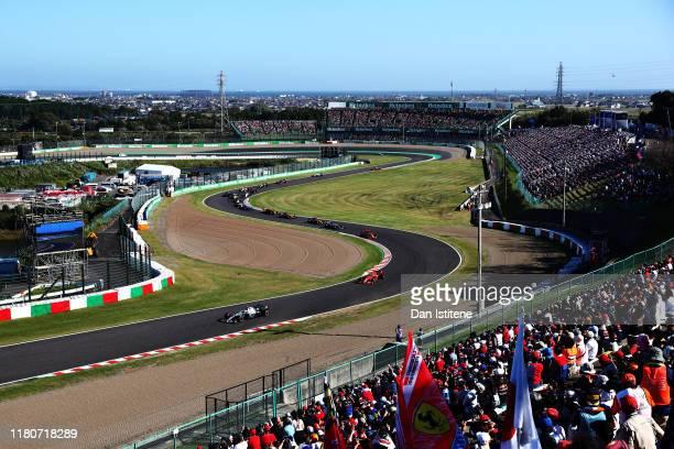 Valtteri Bottas driving the Mercedes AMG Petronas F1 Team Mercedes W10 leads Sebastian Vettel of Germany driving the Scuderia Ferrari SF90 on lap one...