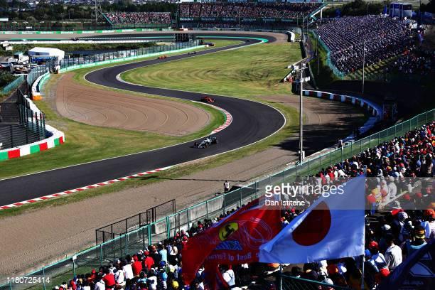 Valtteri Bottas driving the Mercedes AMG Petronas F1 Team Mercedes W10 leads Sebastian Vettel of Germany driving the Scuderia Ferrari SF90 on track...
