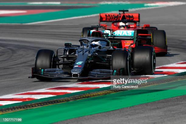 Valtteri Bottas driving the Mercedes AMG Petronas F1 Team Mercedes W11 leads Sebastian Vettel of Germany driving the Scuderia Ferrari SF1000 during...