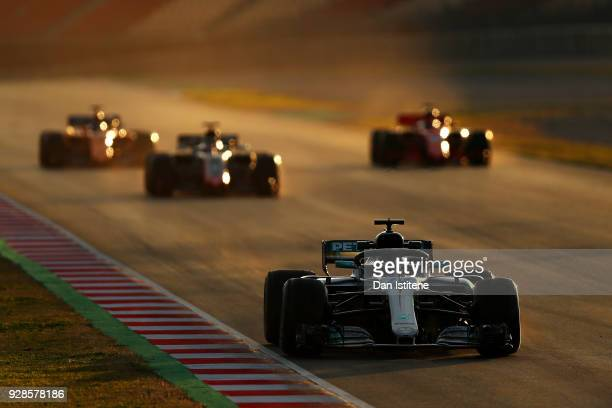 Valtteri Bottas driving the Mercedes AMG Petronas F1 Team Mercedes WO9 leads three cars during a practice start during day two of F1 Winter Testing...