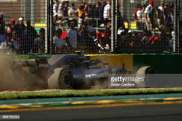 Valtteri Bottas driving the Mercedes AMG Petronas F1 Team Mercedes WO9 runs wide during practice for the Australian Formula One Grand Prix at Albert...
