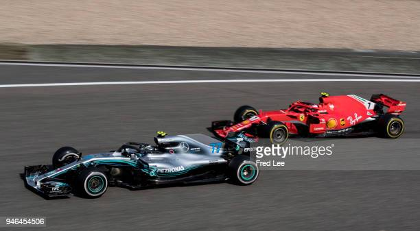 Valtteri Bottas driving the Mercedes AMG Petronas F1 Team Mercedes WO9 Racing leads from Kimi Raikkonen of Finland driving the Scuderia Ferrari SF71H...