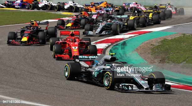 Valtteri Bottas driving the Mercedes AMG Petronas F1 Team Mercedes WO9 leads Kimi Raikkonen of Finland driving the Scuderia Ferrari SF71H on track...