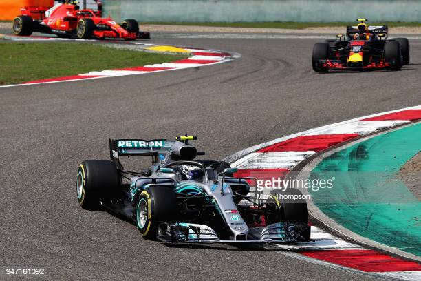 Valtteri Bottas driving the Mercedes AMG Petronas F1 Team Mercedes WO9 leads Max Verstappen of the Netherlands driving the Aston Martin Red Bull...
