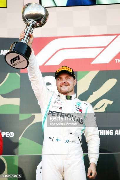 Valtteri Bottas of Finland and Mercedes GP celebrates on the podium during the F1 Grand Prix of Japan at Suzuka Circuit on October 13, 2019 in...