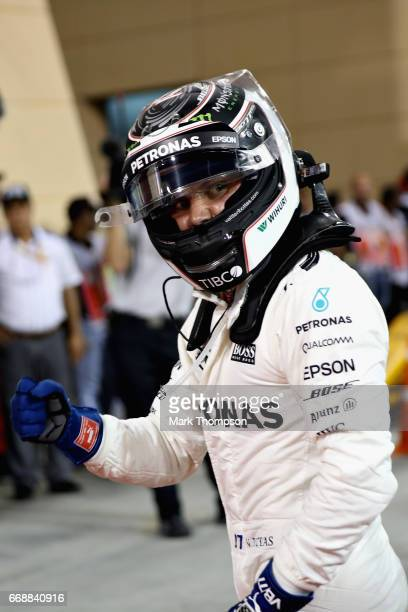 Valtteri Bottas of Finland and Mercedes GP celebrates qualifying in pole position in parc ferme during qualifying for the Bahrain Formula One Grand...