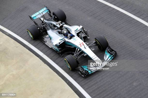 Valtteri Bottas of Finland and Mercedes GP drives during the launch of the Mercedes formula one team's 2017 car the W08 at Silverstone Circuit on...